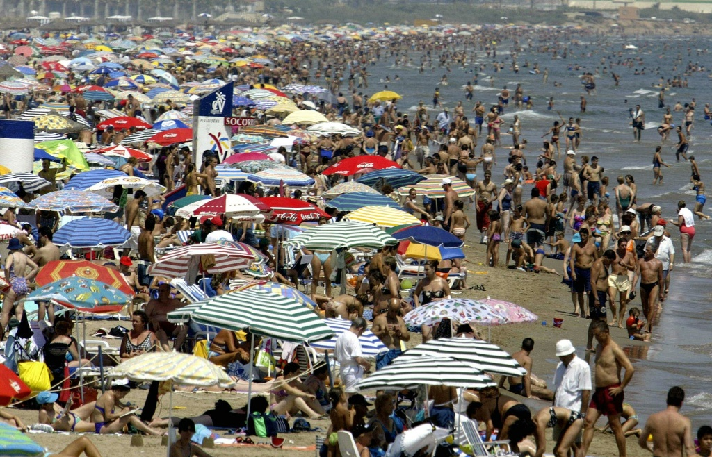 Crowded Malvarrosa beach in Valencia, Spain.