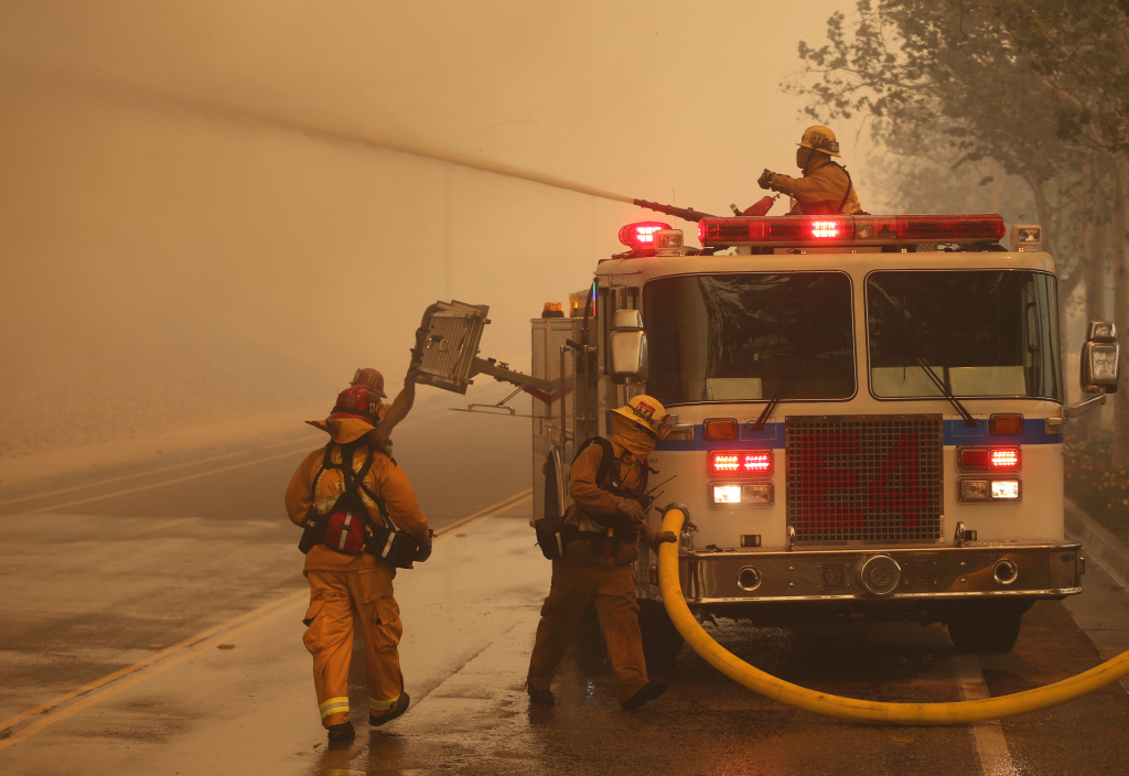 RANCHO CUCAMONGA, CA - APRIL 30: Firefighters battle the wind driven Etiwanda fire burning very close to homes on April 30. 2014 in Rancho Cucamonga, California. Flames from the fire which started in the San Bernardino National Forest spread quickly down the mountain into Ranch Cucamonga. (Photo by Jonathan Alcorn/Getty Images)