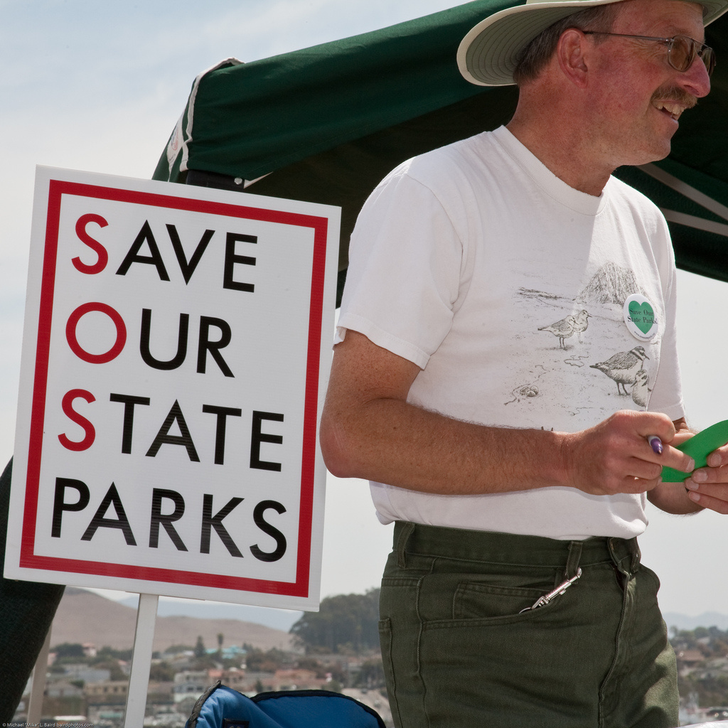 Community members gather signatures in support of state parks during an event on August 28, 2009.