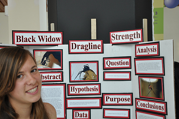 Caitlin Redak, a ninth-grade student at John W. North High School in Riverside, next to her science project at the California State Science Fair in Los Angeles, May 18, 2010.