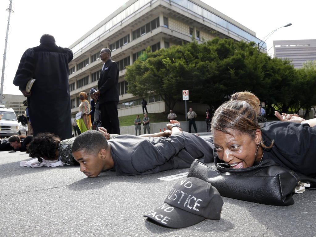 Gidget Bell (right), of Charlotte, joins other protesters in shutting down Fourth Street after a mistrial was declared in Charlotte-Mecklenburg police officer Randall Kerrick's trial.