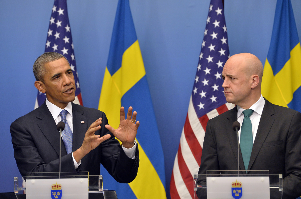 US President Barack Obama (L) answers a question on Syria during a joint press conference with Swedish Prime Minister Fredrik Reinfeldt following their bilateral meeting at the Rosenbad Building in Stockholm on September 4, 2013. Obama met with Fredrik Reinfeldt upon arrival in Sweden on a two-day official trip before leaving for Russia, where he will attend G20 summit. Russia on Thursday hosts the G20 summit hoping to push forward an agenda to stimulate growth but with world leaders distracted by divisions on the prospect of US-led military action in Syria.