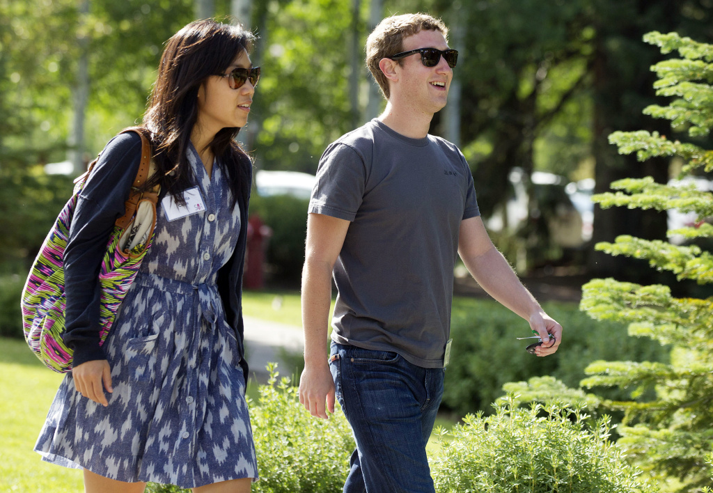 Mark Zuckerberg, right, president and CEO of Facebook, walks to morning sessions with his then-girlfriend (now wife) Priscilla Chan during the 2011 Allen and Co. Sun Valley Conference, Saturday, July 9, 2011, in Sun Valley, Idaho. The two top the 2013 Philanthropy 50 list.