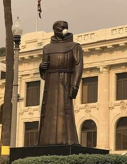 A statue of Father Junipero Serra wearing an air filter during the Thomas Fire in December 2017.