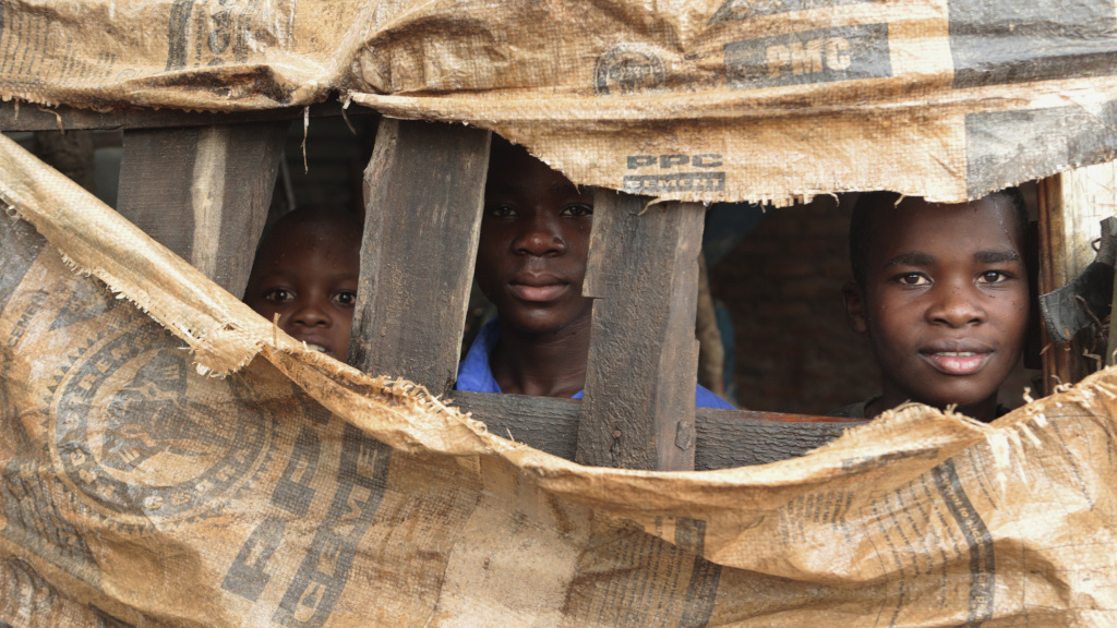 Children in a makeshift shelter near Harare, Zimbabwe. Cyclone Idai has displaced thousands in southern Africa.