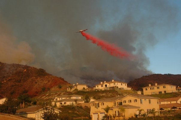Firefighters drop retardant during the Santiago Fire in Orange County in 2007.  The wind-driven wildfire destroyed a dozen homes.
