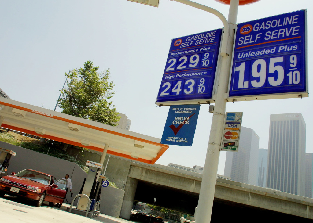 A motorists pumps gas 09 May 2001 at a downtown Los Angeles gas station where self-service prices for a gallon of gasoline range from $1.95 to $2.43.