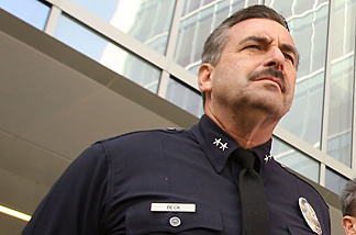 Deputy Chief Charlie Beck looks on as Los Angeles Police chief William Bratton holds his last press conference outside the new Police Administration Building on October 28, 2009 in Los Angeles, California.