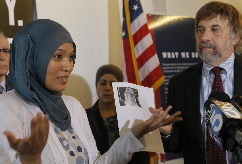 Imane Boudlal speaks during a news conference at the ACLU with her lawyer  Mark Rosenbaum, chief counsel ACLU in Los Angeles on Monday, Aug. 13, 2012. Boudlal, a former Disneyland employee who says she was forbidden to wear a Muslim head scarf at work plans to sue the Walt Disney Co., for discrimination.