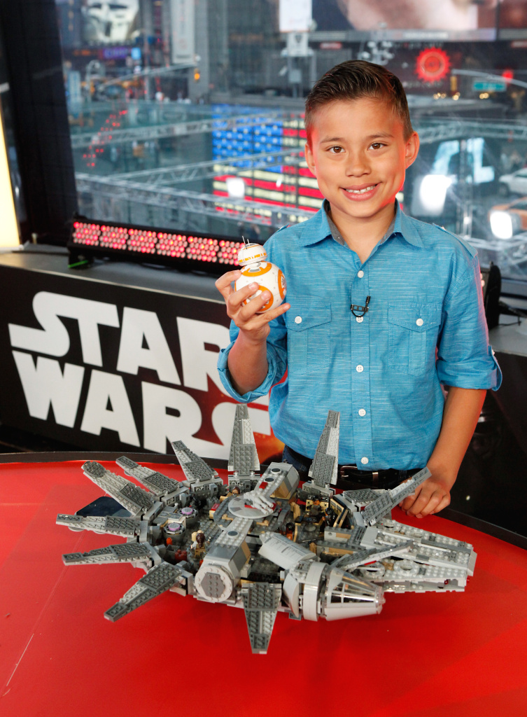 """A fan with LEGO Star Wars Millennium Falcon and Star Wars BB-8 from Sphero at a live unboxing event on """"Good Morning America"""" TV show in New York City on Sept. 3, 2015."""