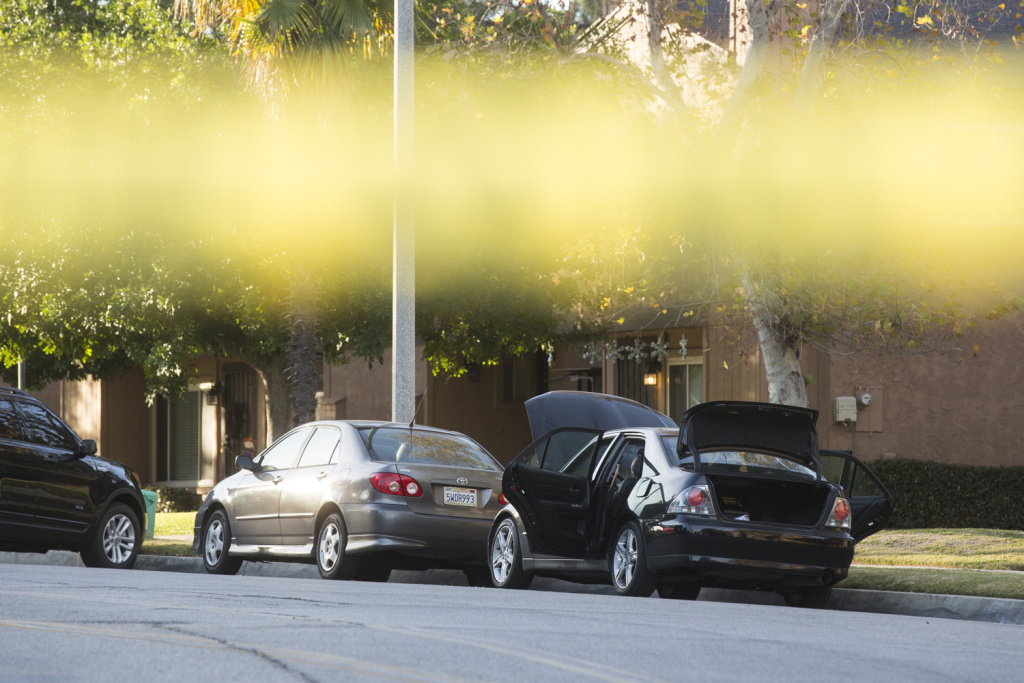 N Center Street between Pine Street and N Center Place remains closed as authorities continue to search a Redlands home on Thursday morning, Dec. 3, 2015 following Wednesday's mass shooting at in San Bernardino. The hood, doors and trunk of a car remain open outside the residence.