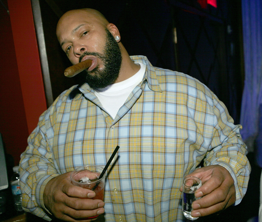 "Ex-rap music mogul Marion ""Suge"" Knight was arrested Thursday after he allegedly pointed a gun at a man and then drove off in his Cadillac, police said."