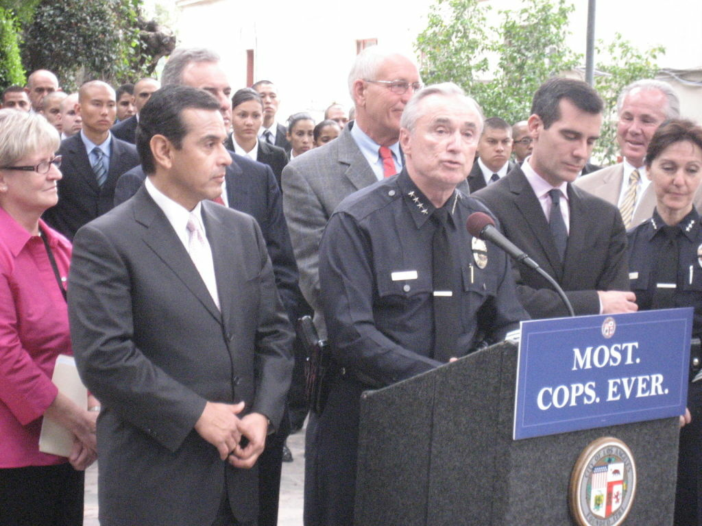 Los Angeles officials seek the public's input on who should replace this man.  One of the candidates is the woman on the far right, LAPD Assistant Chief Sharon Papa.
