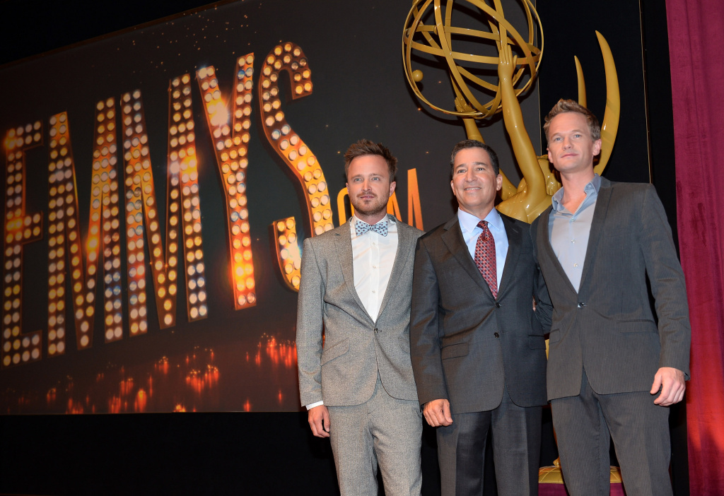 (L-R) Actor Aaron Paul, Academy of Television Arts & Sciences Chairman & CEO Bruce Rosenblum and actor Neil Patrick Harris pose onstage following the 65th Primetime Emmy Awards nominations announcements at the Television Academy's Leonard H. Goldenson Theatre on July 18, 2013 in North Hollywood, California.