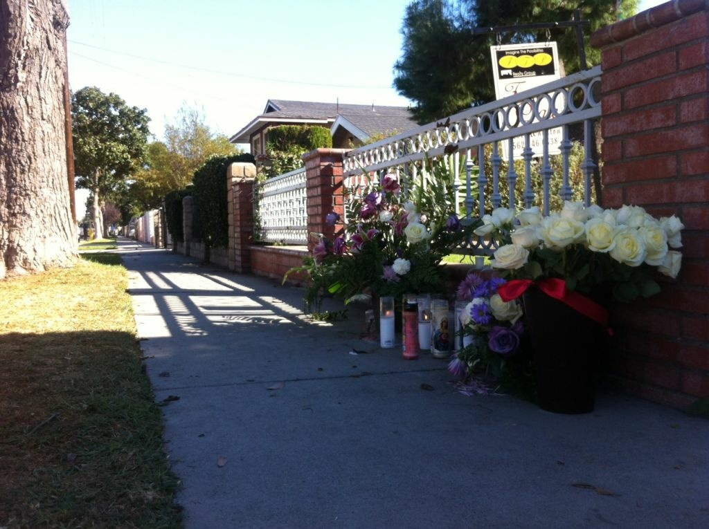 A memorial for Jose de la Trinidad on East 122nd Street, where he was shot and killed by L.A. County sheriff's deputies.