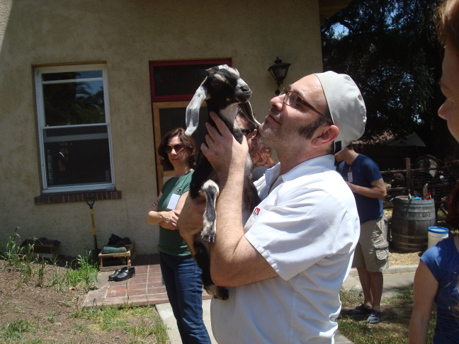 Institute of Domestic Technology instructor Stephen Rudicel holds Poppyseed the goat