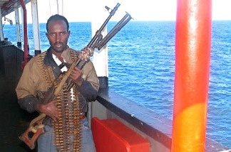 A Somali gunman carries a Russian-made long range machine gun.