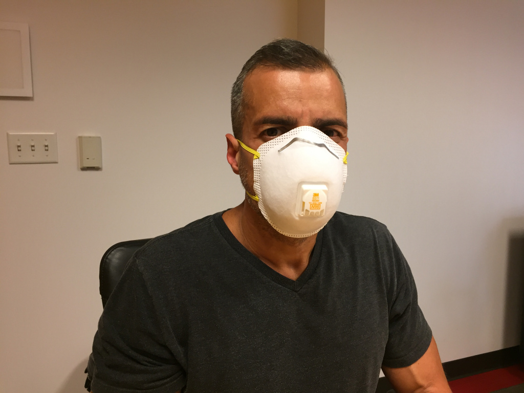 A Martinez tries on the N95 with ventilation.