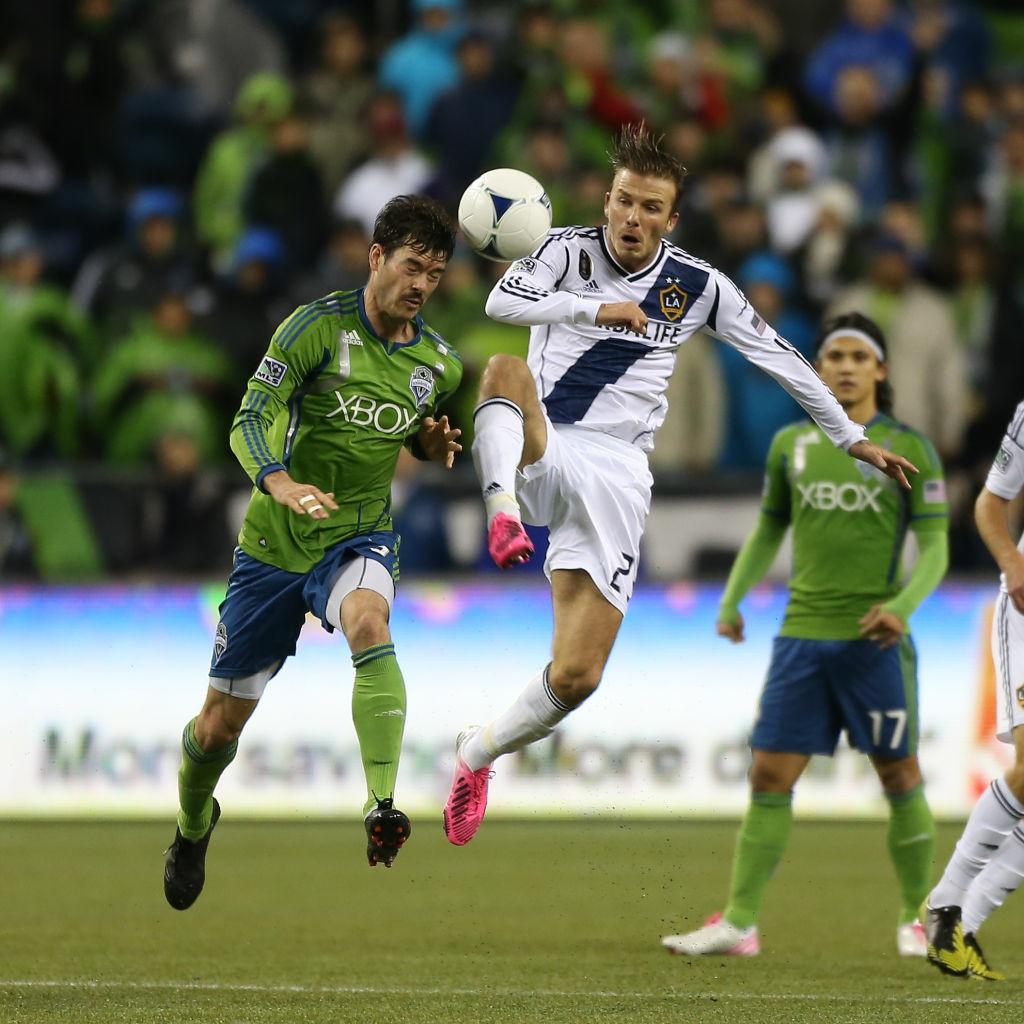 David Beckham battles for the ball against the Seattle Sounders in the MLS Western Conference  finals on November 18, 2012 in Seattle. (Photo by Otto Greule Jr/Getty Images)