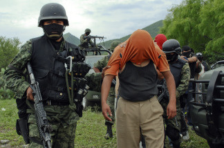 A group of people kidnapped by alleged drug-traffickers, are escorted during their freeing by members of the Mexican Army, in Sabinas Hidalgo, 99 km north of Monterrey, Nuevo Leon State, Mexico, on April 27, 2010.