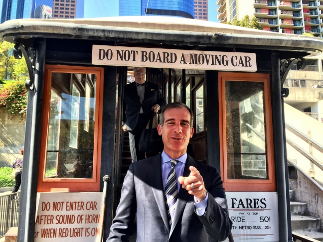 LA Mayor Eric Garcetti, aboard the Angels Flight railway on Wednesday, March 1, 2017, after announcing the historic funicular will be back in operation by Labor Day. Behind him on the train is John Welborne, who was caretaker of the train for many years.