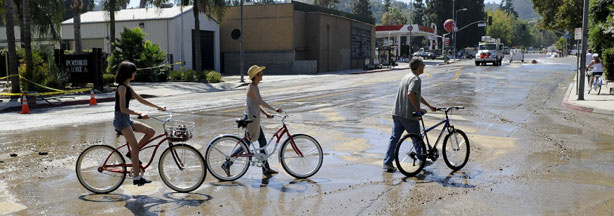 Residents cross what would normally be a busy Coldwater Canyon Avenue to inspect the damage after a 64-inch main broke Sept. 5, 2009, sending a deluge of water down Coldwater Canyon Avenue to Ventura Boulevard in the Studio City section of Los Angeles, flooding streets and businesses, Sunday, Sept. 6.