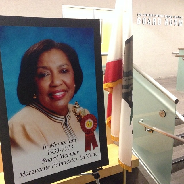 A memorial image of Marguerite LaMotte on display at the board meeting.