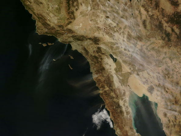 File: An image captured by NASA's Terra satellite shows several fires giving off small plumes of smoke October 21, 2007.