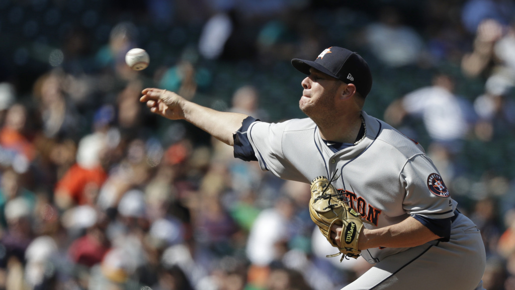 Houston Astros relief pitcher Brad Peacock delivers the ball during an Aug. 1 game against the Seattle Mariners in Seattle. A month later, he became the third known player in the league diagnosed with hand, foot and mouth disease this season.