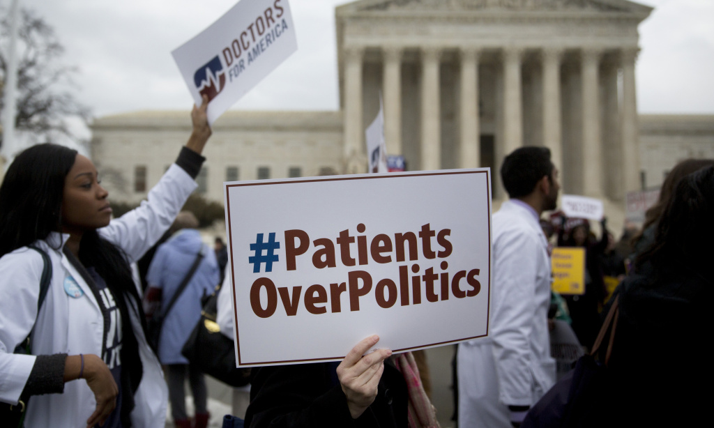 Demonstrators from Doctors for America marched in support of the Affordable Care Act outside the U.S. Supreme Court in March 2015. Now, another case aims to undo the federal health law: Texas v. United States could land in front of the Supreme Court ahead of the 2020 election.
