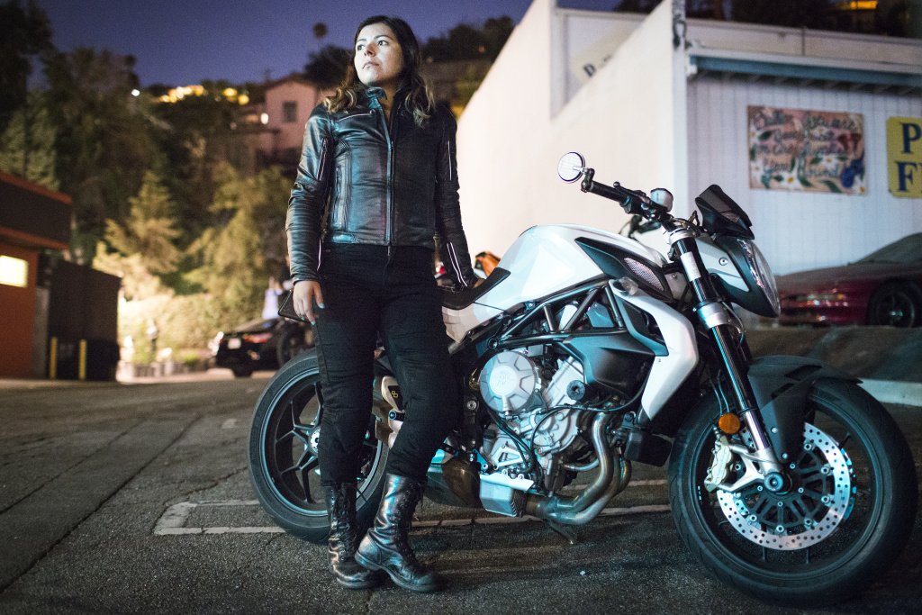 Maria Delgado gets ready to ride with the Eastside Moto Babes on a 2013 Brutale 675 during the group's weekly Tuesday night ride on August 2, 2016 from the Tomato Pie Pizza Joint parking lot in Silverlake.
