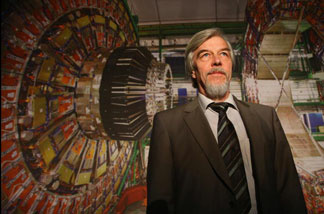 Rolf-Dieter Heuer, the director of CERN, the European Organization for Nuclear Research, poses in front of a giant photograph of the CMS detector of the Large Hadron Collider (LHC) at the 'Weltmaschine' ('World Machine') exhibition on October 14, 2008 in Berlin, Germany.