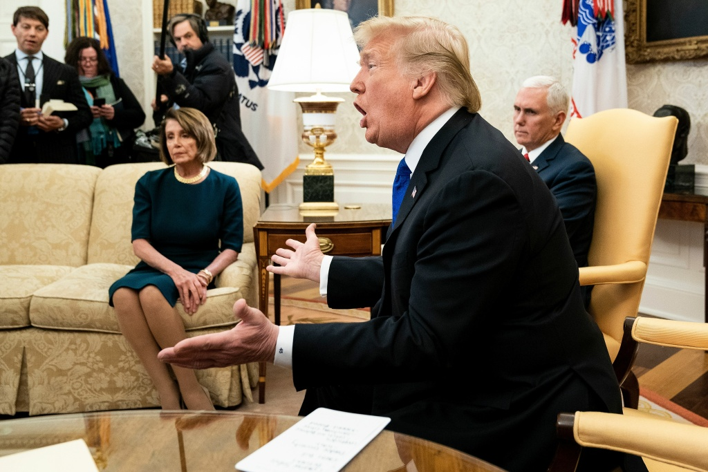 Presumptive Speaker, House Minority Leader Nancy Pelosi (D-CA) (L) and US Vice President Mike Pence (R) listen while US President Donald Trump makes a statement to the press before a meeting at the White House December 11, 2018 in Washington, DC.