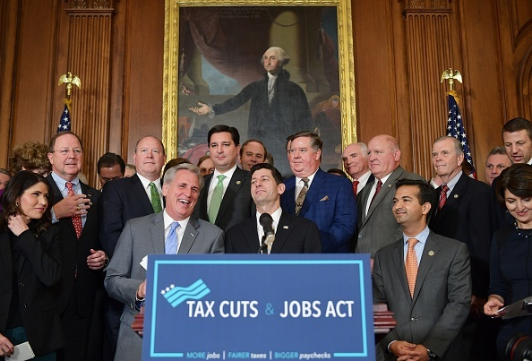 House Majority Leader Kevin, R-CA, laughs with House Speaker Paul Ryan, R-WI, during a press conference after the House passed its version of the Republican tax overhaul in the Rayburn Room of the US Capitol on November 16, 2017 in Washington, DC.