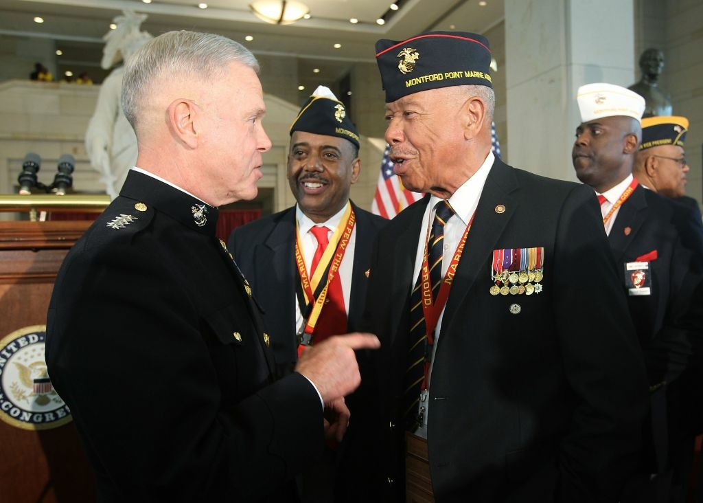 Commandant of the U.S. Marine Corps General James F. Amos (L) greets William McDowell (3rd L), a representative of the Montford Point Marines to receive the Congressional Gold Medal, during a presentation ceremony at the Emancipation Hall of the Capitol Visitor's Center June 27, 2012 on Capitol Hill in Washington, DC. The Montford Point Marines was recognized for being the nation's first African-American Marines who received basic training at Montford Point Camp, New River, N.C. from 1942 to 1949, and their services to the country.