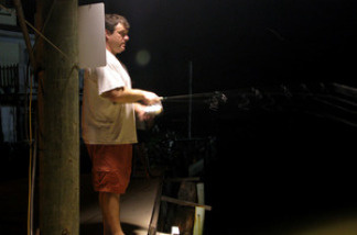 Bryan Casey does a bit of night fishing in an undisclosed location near Grand Isle, La.