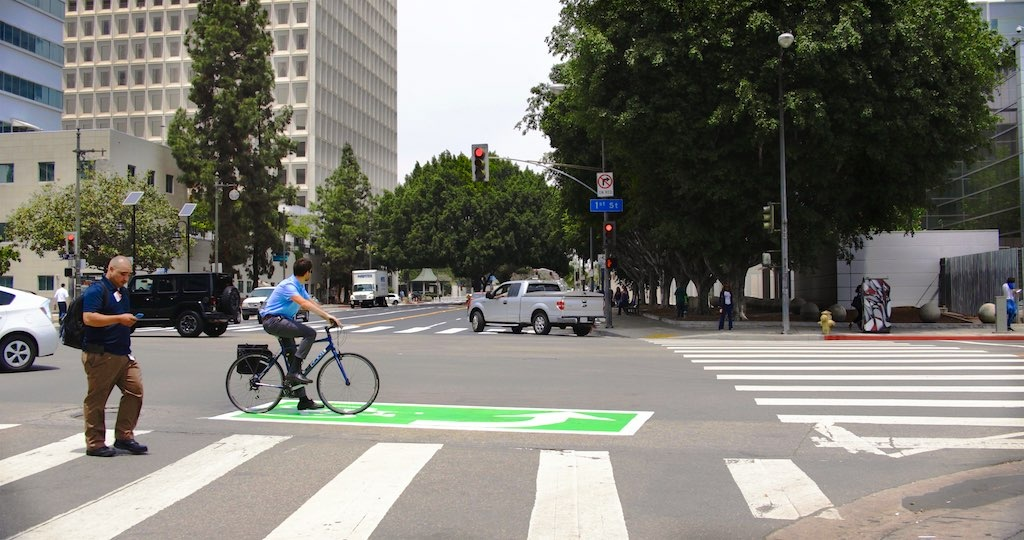A green left-turn box for bicyclists is seen at a newly marked section of Los Angeles Street in downtown L.A intended to make it easier for pedestrians, bikes and cars to share the road.