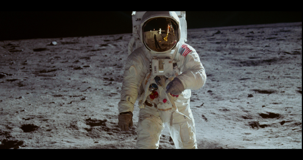 An image of Neil Armstrong and Buzz Aldrin walking on the surface of the moon from NEON's documentary 'Apollo 11'