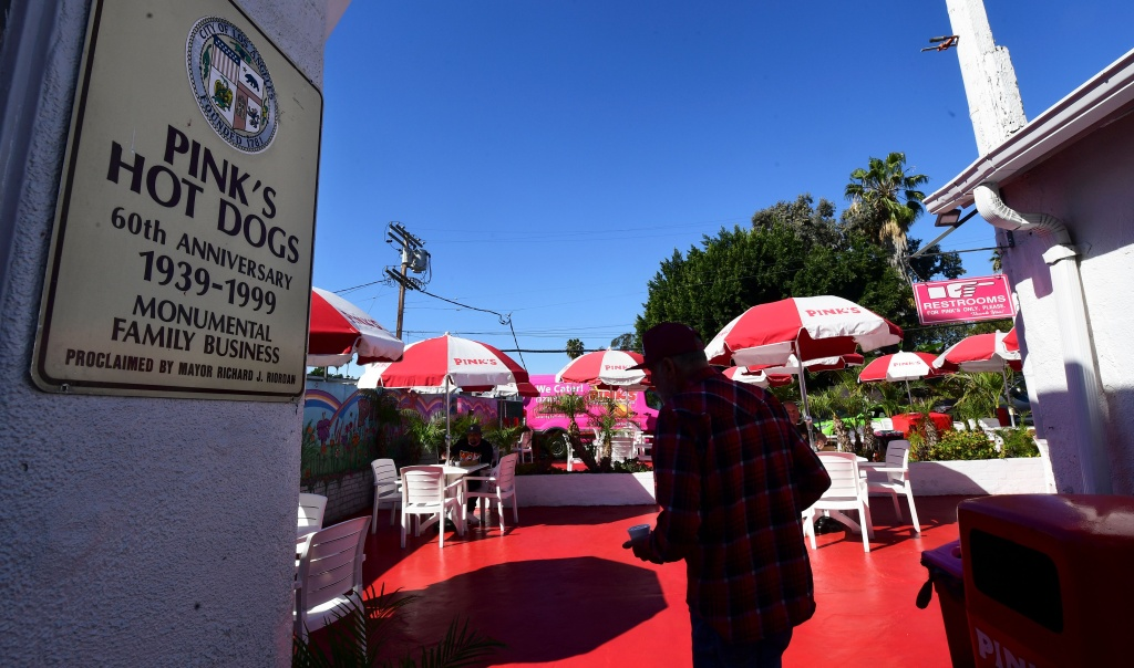 A man makes his may to the outdoor patio at the reopening of iconic LA restaurant Pink's Hot Dogs on March 1, 2021 in Los Angeles, California.