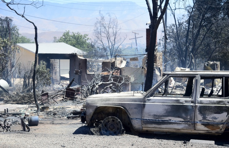 Rubble from a demolished home with vehicle out front are seen in the community of Squirrel Valley in Lake Isabella, California on June 24, 2016.