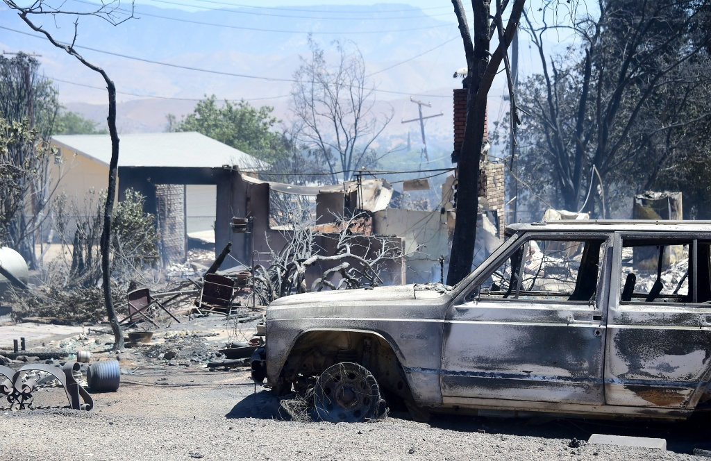 The remains of a demolished home with vehicle out front are seen in the community of Squirrel Valley in Lake Isabella, California on June 24, 2016.