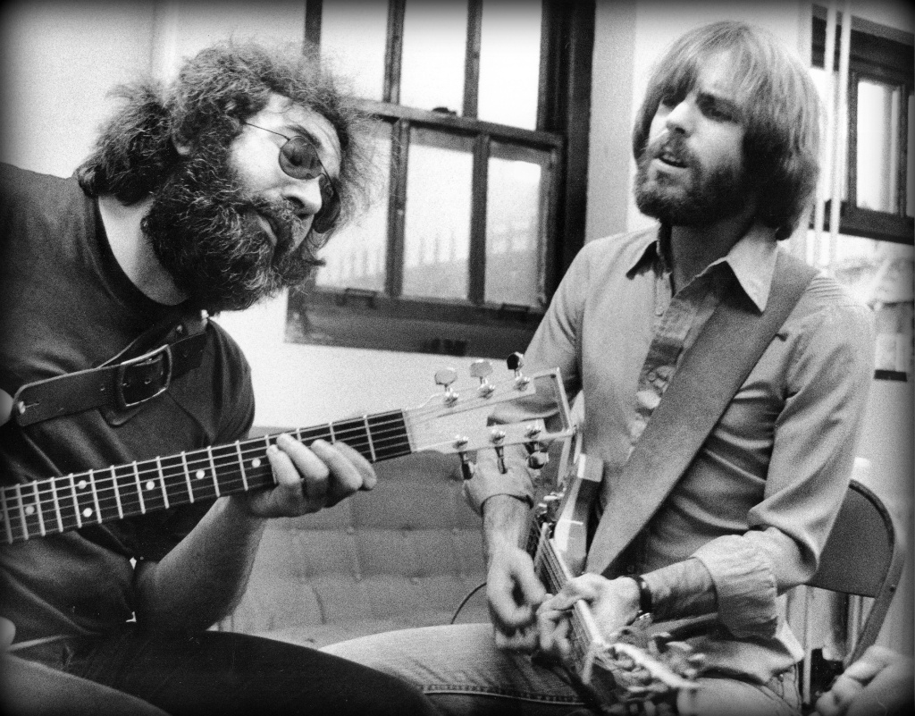 Jerry Garcia and Bob Weir backstage in 1977. Photographer: Peter Simon