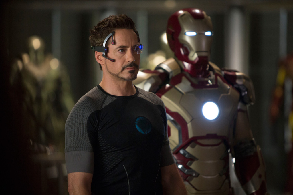 Actor Robert Downey Jr. with one of the Iron Man suits in a still from