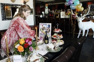 Pub owner Golriz Moeini decorates her White Harte Pub on April 5, 2011, with items she plans to use for her royal wedding watch party at the pub in Woodland Hills, Calif.