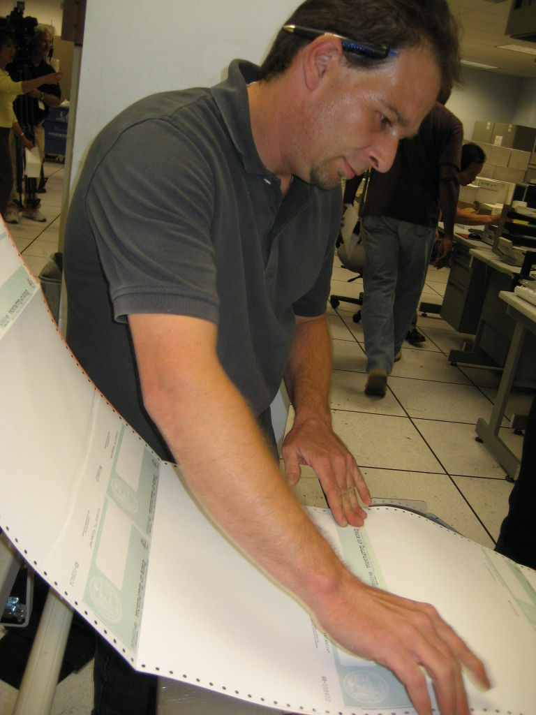 State Controller worker Shawn Taylor printing IOUs
