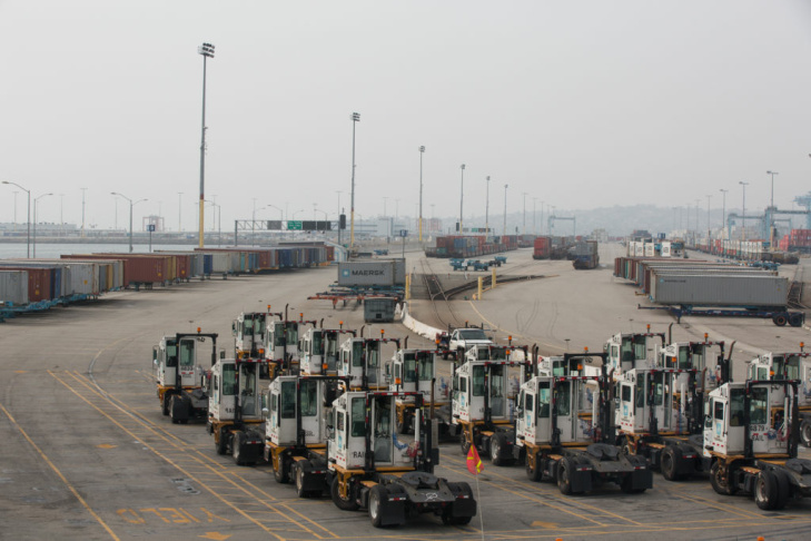 Trucks remain idle at the APM Terminals at the Port of Los Angeles as a result of the clerical workers strike.