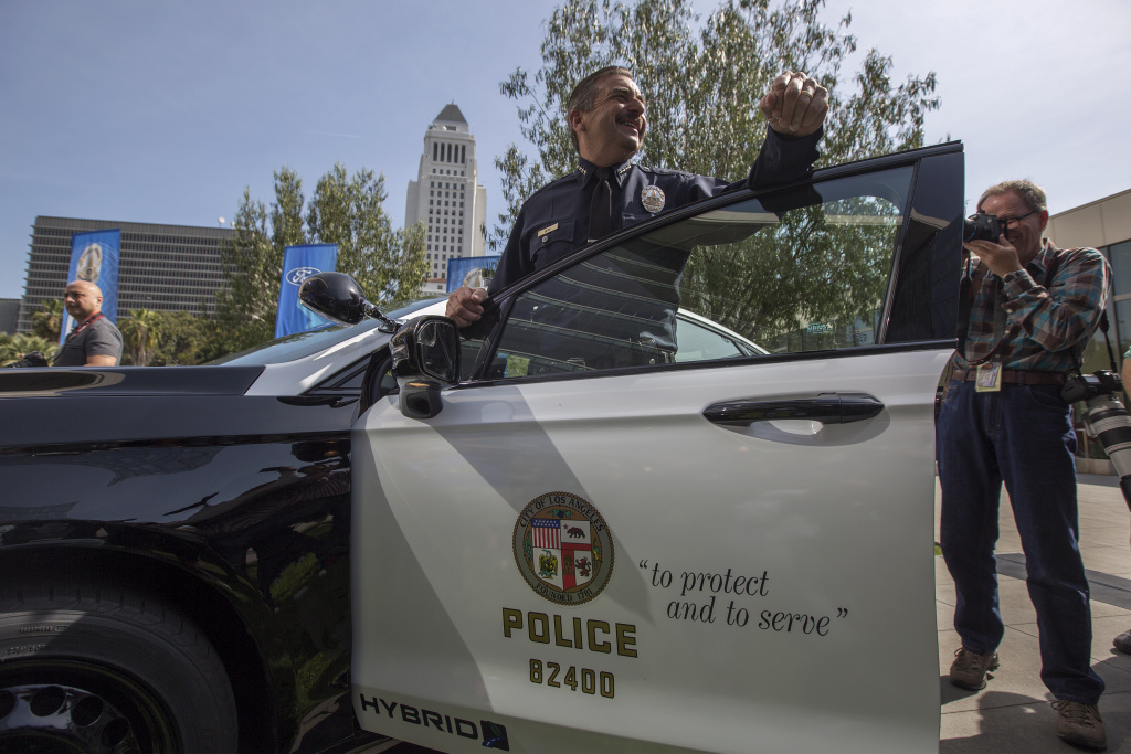 LAPD Chief Charlie Beck stands at one of two new Ford Fusion hybrid pursuit-rated Police Responder cars unveiled at Los Angeles Police Department headquarters on April 10, 2017.