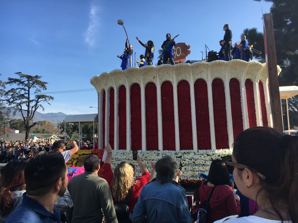 The band Earth, Wind & Fire plays atop a float depicting the Inglewood Forum for the 2018 Rose Parade audience. The addition of live entertainment to a float is an example of how the parade is amping up the entertainment on the floral-covered floats.