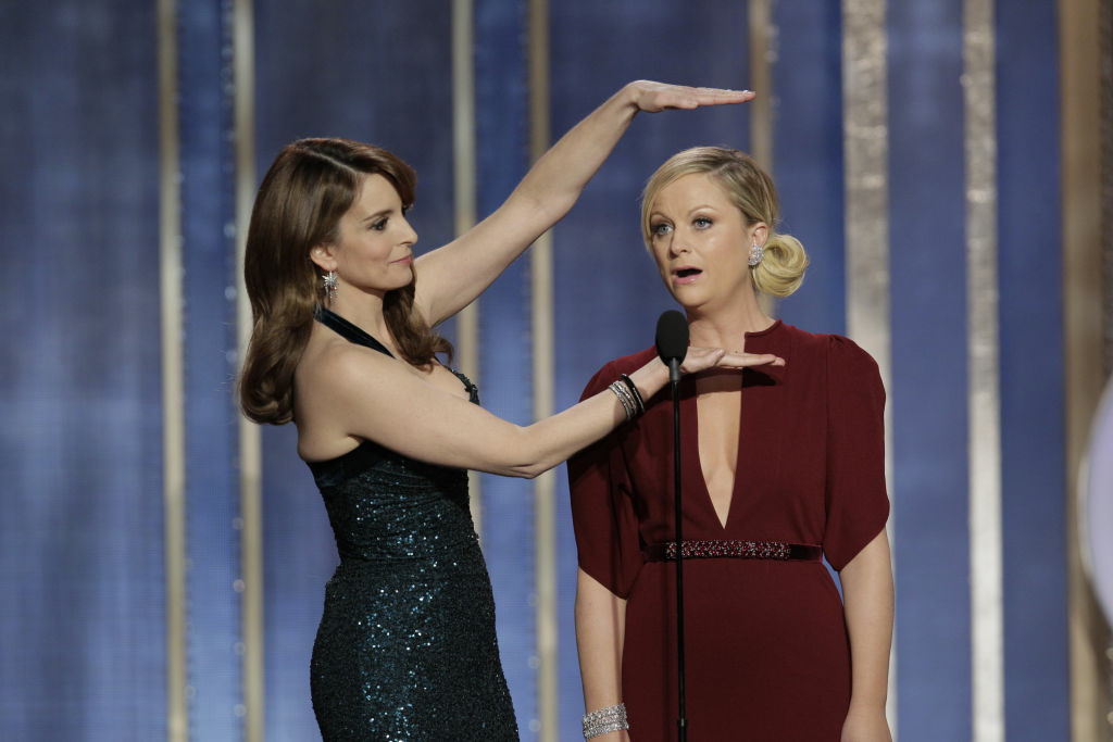 In this handout photo provided by NBCUniversal,  L to R Tina Fey and Amy Poehler host the 70th Annual Golden Globe Awards at the Beverly Hilton Hotel International Ballroom on January 13, 2013 in Beverly Hills, California.