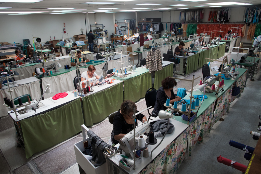 Workers at Karen Kane sew small batches of samples in their local warehouse to test out new designs. Karen Kane can now produce its line faster in the states than it did in China.